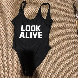 Black low back one piece bathing suit